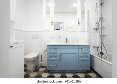 Classical white bathroom interior with blue cabinet