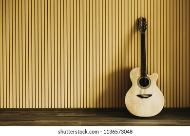 classical yellow guitar of wood indoor near of the yellow wood panel
