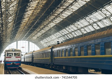 classicistical railway station with trains on it