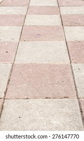 Classified stone's pink stripes on the pavement.
