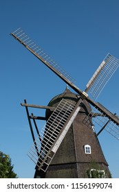Classing windmill against a blue skie