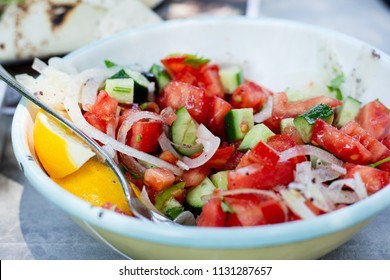 Classis Turkish salad with tomato, cucumber, onion and olive oil (selective focus)