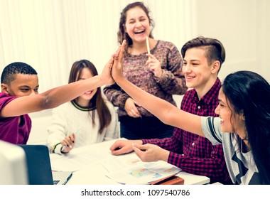Classmates giving a high five teamwork and success concept