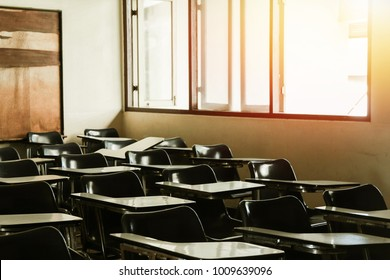 Classroom in background without ,No student or teacher . with Sunset limelight near window.