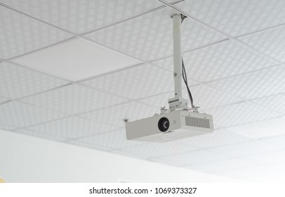 Classroom ceiling white projector oblique side