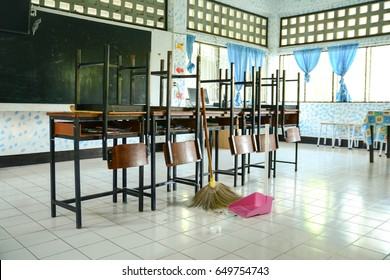Classroom cleaning with a broom