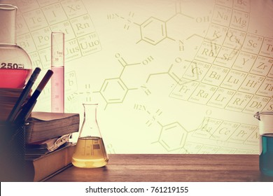 Classroom desk of chemistry teaching with books and instruments. Chemical sciences education concept. Horizontal composition. Front view