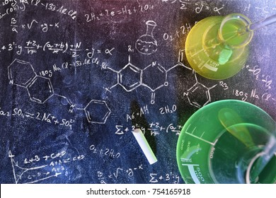 Classroom desk and drawn blackboard of chemistry teaching with books and instruments. Chemical sciences education concept. Horizontal composition. Top view
