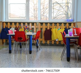 classroom in kindergarten with red small chairs and tables