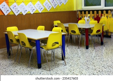 classroom of a preschool with the little yellow chairs