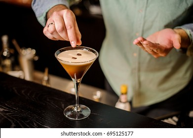 classy bartender garnish martini espresso cocktail drink white foam coffee bean on top bar counter