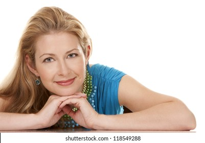 classy blond woman in her 40s wearing turquois dress