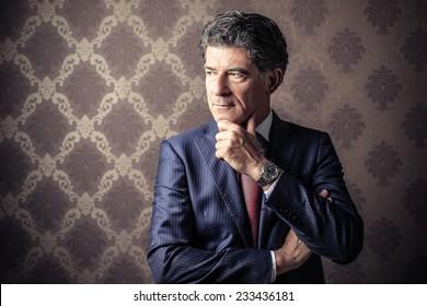 Classy businessman posing