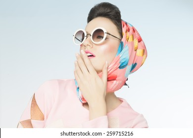 Classy chic sixties style fashion retro woman. Sunglasses and silk scarf.
