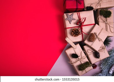 Classy Christmas gifts box presents on red and grey background. Flat lat winter composition. Top view and copy space