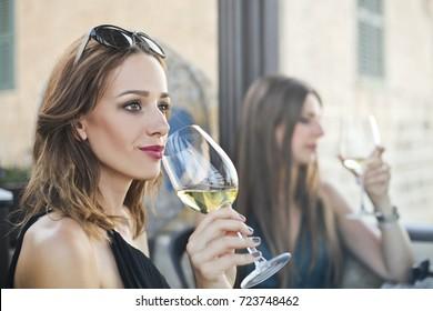 Classy girls drinking a glass of wine
