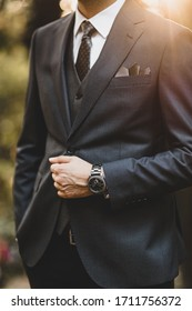 A classy groom dressed in a suit.