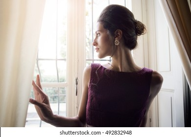 Classy lady looking out of the window
