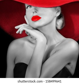 classy lady in red hat black and white portrait