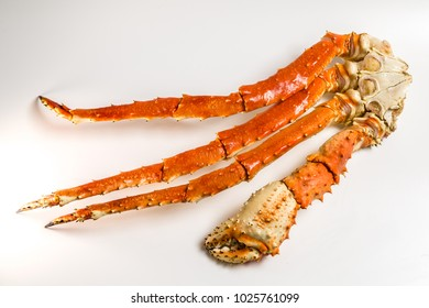 claw of a king crab on a white background