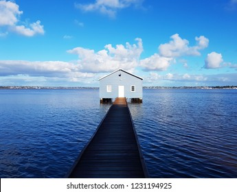Clawley Edge Boatshed (Blue Boat House) on the Swan river with wooden jetty