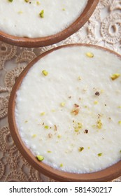 Clay bowls of phirni on table