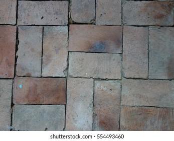 Clay brick floor.