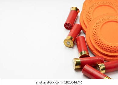 Clay disc flying targets and shotgun bullets on white background ,Clay Pigeon target