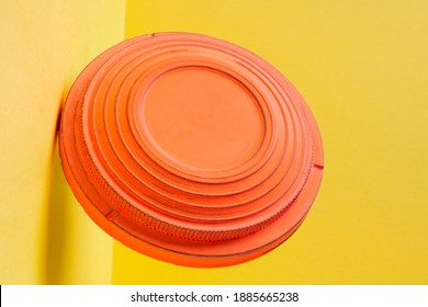 Clay disc target for skeet shooting flying against the colorful yellow background. Clay pigeon shooting