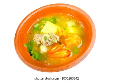 clay dish deep, soup with fresh herbs, meat beef, pork, potatoes, hot red pepper, liquid isolated on white background