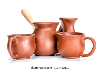 Clay dishes. Cups and a Turk on a white background