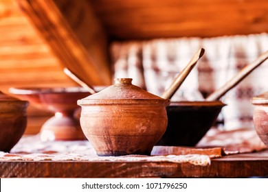 Clay dishes on old wooden background