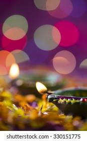 Clay diya lamps lit during Diwali Celebration. Greetings Card Design Indian Hindu Light Festival called Diwali.