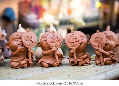 Clay doll on bamboo table.