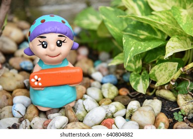 Clay Doll / Doll ornamental  in the garden
