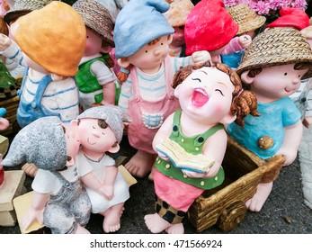 Clay dolls in the garden