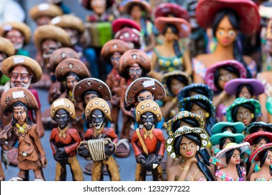 Clay dolls. Clay dolls from the north of Brazil. Clay dolls from Brazil. Concept of musicians and women.