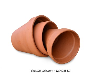 Clay flower pots isolated on white background, different sizes stacked