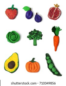 Clay fruits and vegetables  in isolated background