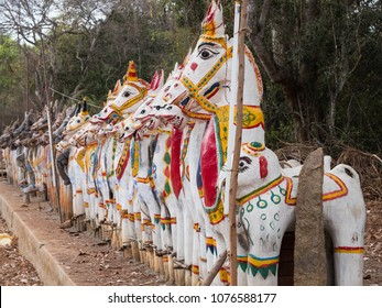 Clay horses assembled in homage to the god Ayyanar at Pallathur in Tamil Nadu, India.  Ayyanar is the mythical guardian of local villages which he reputedly patrols at night on horseback to protect