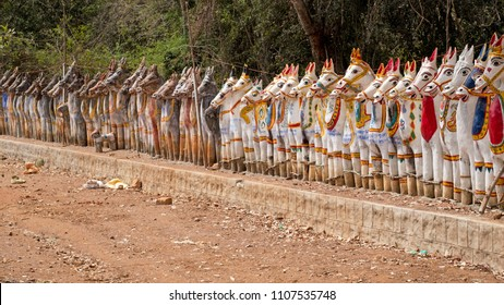 Clay horses lined up in homage to the Hindu god Ayyanar outside the Solai Andavar temple at Pallathur, India. Ayyanar, the mythical guardian of villages, is thought to patrol them nightly on horseback