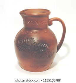 Clay jug isolated on a white background