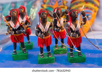 Clay made tribal men dolls with bow and arrow, terracotta handicrafts, art of Bankura and Bishnupur , on display during the Handicraft Fair in Kolkata , West Bengal, India.