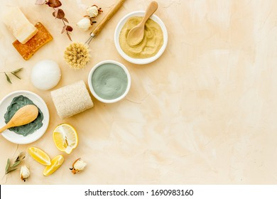 Clay mask in bowl for facial spa on beige background top view copy space