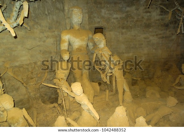 clay models in a hell-floor in Laos