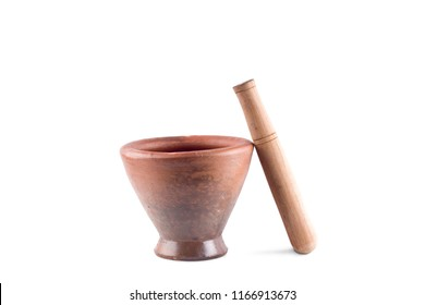 Clay mortar and wood pestle is used to mix the ingredients on white background  cooking kitchenware object isolated
