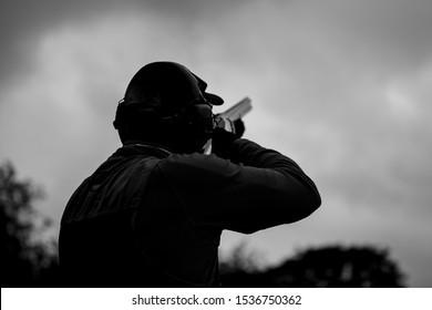 clay pigeon shooting with shotgun