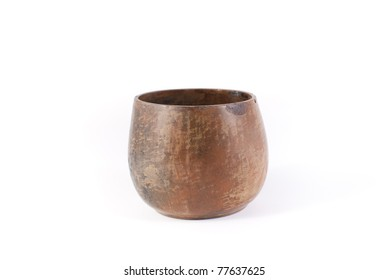 Clay pot of brown color on a white background
