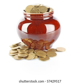 Clay pot with golden coins isolated on white background