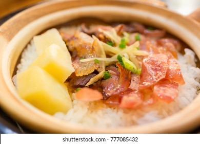 clay pot rice with bacon and sausage and potato